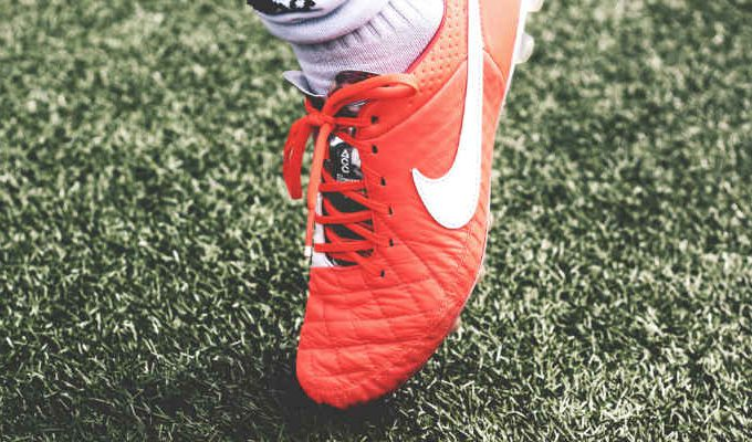 A red football boot. Image: Unsplash.com.