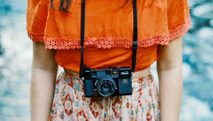 A photo of a woman and a camera from Unsplash: A free stock photo site.