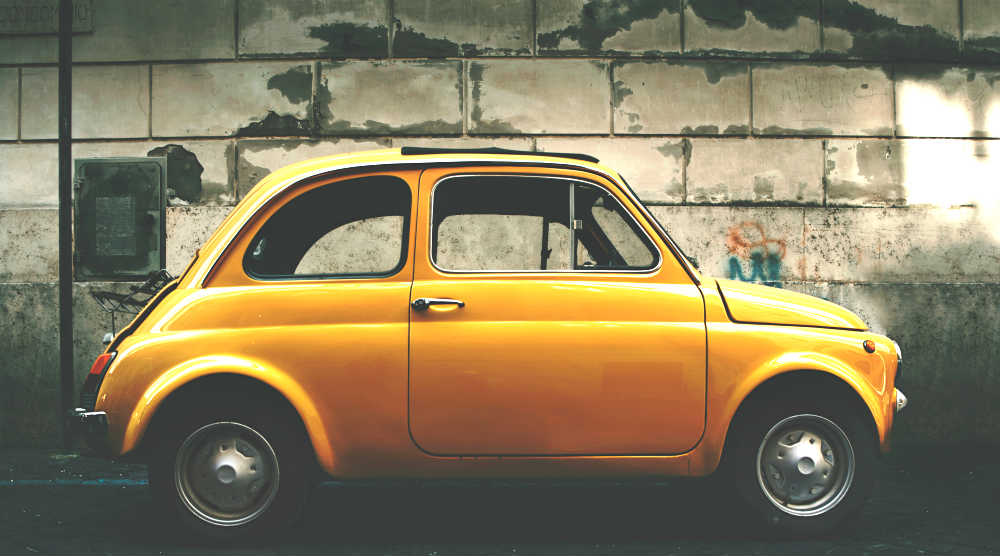 A photo of a yellow Fiat on the free stock photo site Negative Space.