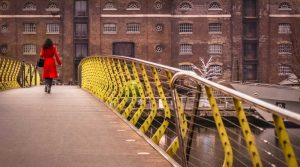A photo of a woman on a bridge from free stock photo site Snappier Snaps.