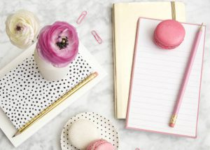 A girly styled free stock photos of a desktop and stationery by Elle Drouin.