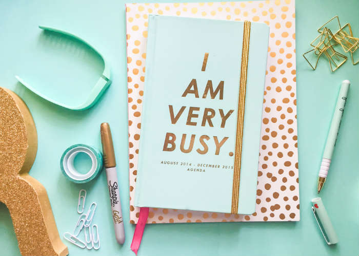 A free girly styled stock photo of a desktop, with stationery items by Rekita Nicole.