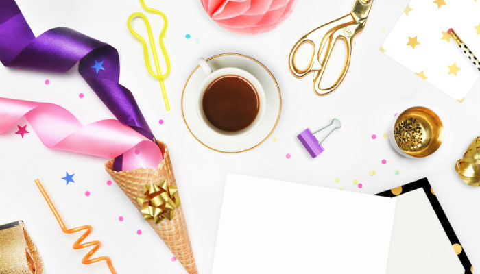 A free feminine styled flatlay stock photo of stationery and a cup from Unsplash.com.
