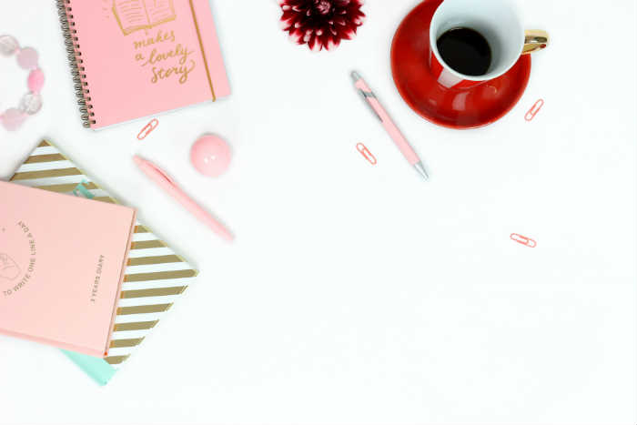 A free girly styled stock image of a desktop and stationery items from Pexels.