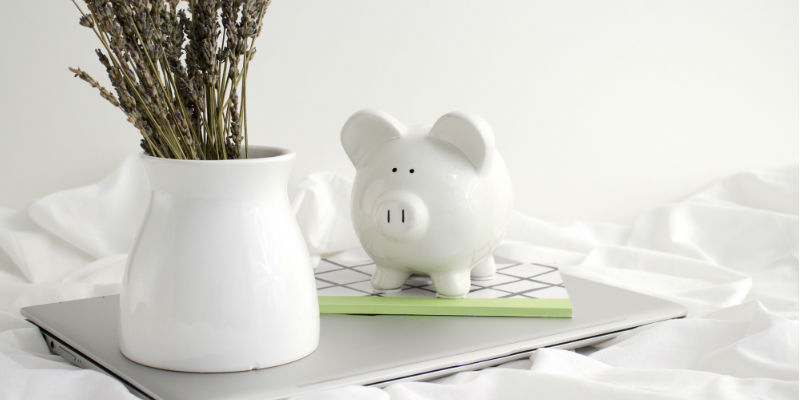 A piggy bank on a laptop. Image: Kayla Butler via Ivorymix.com.